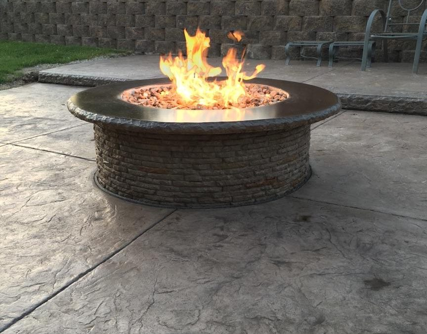 Gas fire pit with stamped two-level patio